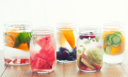 Mason jars with water and fruit