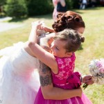Bride hugging young girl