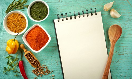 Bowls of spices and blank notebook