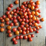 lots-of-sunset-bumblee-tomatoes-on-old-wood
