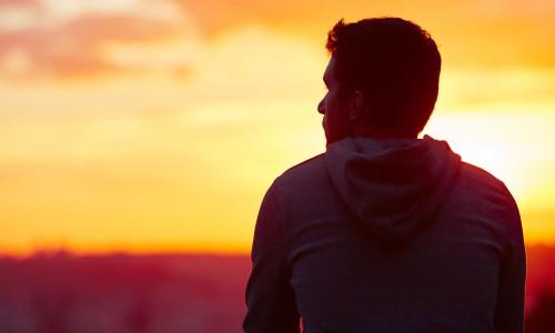 man silhouette against sunset