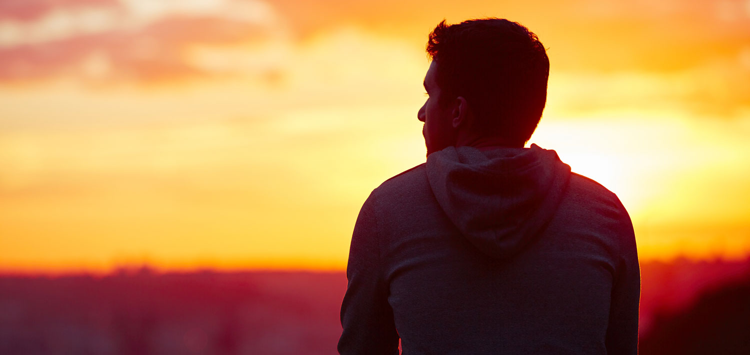 man silhouette against sunset
