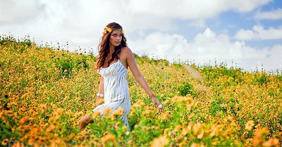 woman in field of flowers